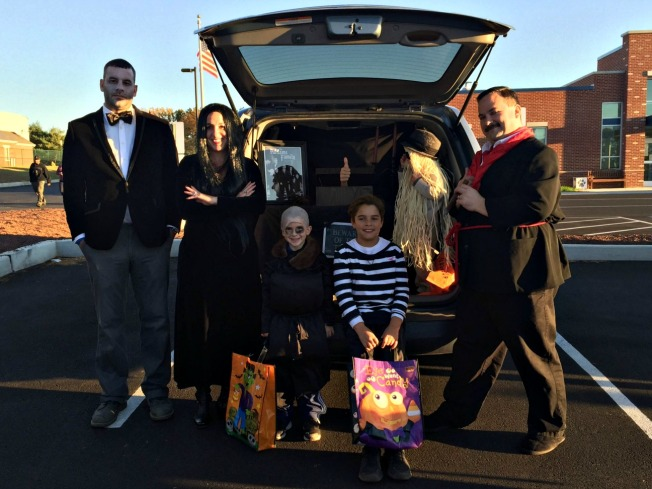 A family at Fern Hill Elementary dressed as the Addams Family for the annual Trunk or Treat. From left, Ron Jackson (Lurch), Amy Simmler (Morticia), Rex Simmler (Uncle Fester), Jake Sousa (Thing), Ben Sousa (Pugsley), Jackson Simmler (Cousin It) and Bill Simmler (Gomez). (Candice Monhollan)