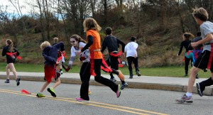 Student zombies chase runners participating in the Knight of the Living Dead 5K to try and capture flags off of their belts during the race on Saturday. (Candice Monhollan)