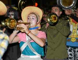 Thousands turned out for the annual West Chester Halloween Parade Thursday evening. The Henderson High School Marching Band joined in the fun. (Pete Bannan)