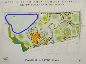 The West Chester Area School District plans to sell approximately 50 acres of land, circled, adjacent to West Chester Rustin High School, to a local home developer. (Candice Monhollan)