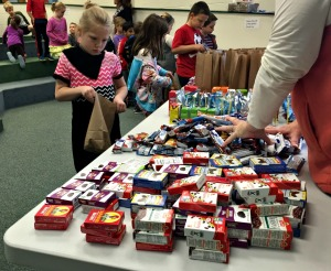 Kindergarten through second graders at East Goshen Elementary School put together breakfast bags to donate to agencies across the county to feed the hungry on Thursday. (Candice Monhollan)