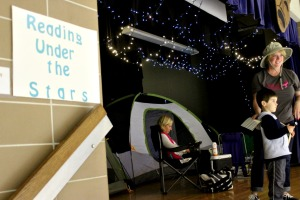 "One of the stations at East Goshen Elementary School's Smart Night was 'Reading Under the Stars,' where students were able to curl up with a book under the ""stars"" on the cafeteria stage. (Candice Monhollan)"