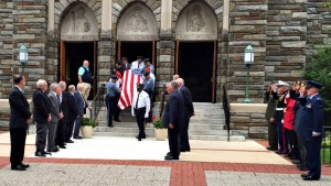 West Chester police and Marine Corps League members carry the coffin of former West Chester Mayor Dick Yoder from St. Agnes Church. Yoder was the two-term mayor of West Chester. He served as mayor from 2002 to 2010, and he was a six-year veteran of the United States Marine Corps. (Candice Monhollan)