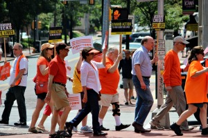 Residents marched around the streets of West Chester on Thursday morning to raise awareness of gun violence and to support background checks for every person when purchasing a firearm. (Candice Monhollan)
