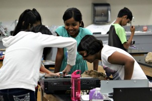 Students were able to take apart old household appliances, such as radios, alarm clocks and more, to help come up with a new invention as part of Camp Invention. (Candice Monhollan)