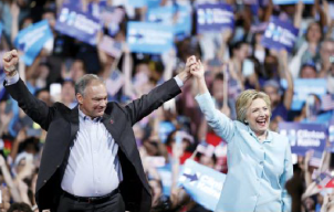 Democratic presidential candidate Hillary Clinton arrives with Sen. Tim Kaine, D-Va., at a rally at Florida International University Panther Arena in Miami Saturday. Clinton has chosen Kaine to be her running mate. (Daily Local News/Associated Press)