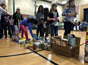 Students at Hillsdale Elementary School create breakfast bags to be given to Safe Harbor in West Chester as part of the Martin Luther King Jr. Day of community service on Friday. (Candice Monhollan)
