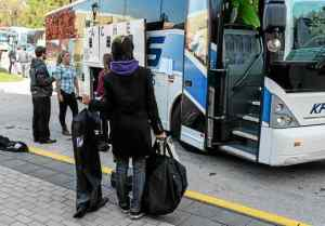 A WCU student and band member waits to board the bus. (Scott Rowan)